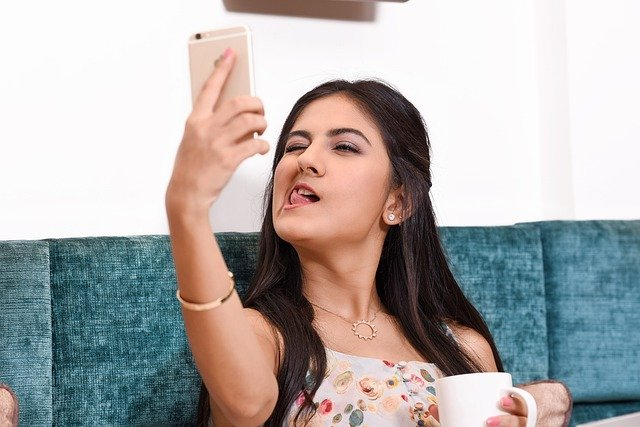 Girl sticking out tongue for a selfie